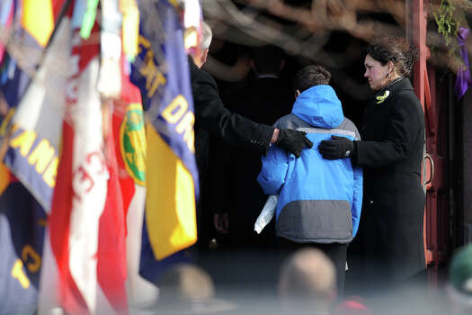 Mourners arrive for the funeral of Benjamin Wheeler, at Trinity Episcopal Church, in Newtown, Conn., Dec. 20th, 2012. Wheeler is one of twenty students killed in the mass shooting at Sandy Hook Elementary School last Friday. Photo: Ned Gerard / Connecticut Post