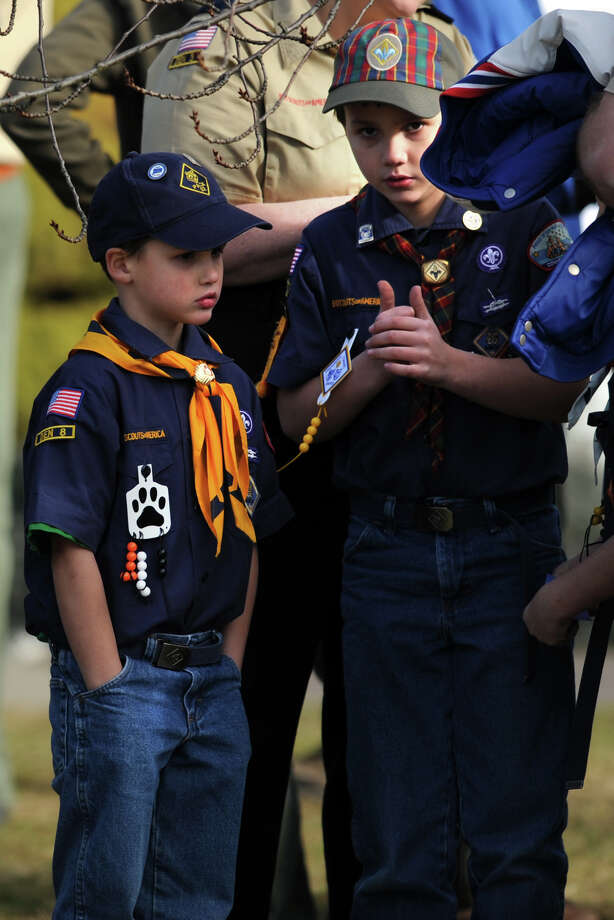 Two cub scout wait outside the funeral of Benjamin Wheeler, at Trinity Episcopal Church, in Newtown, Conn., Dec. 20th, 2012. Wheeler is one of twenty students killed in the mass shooting at Sandy Hook Elementary School last Friday. Photo: Ned Gerard / Connecticut Post