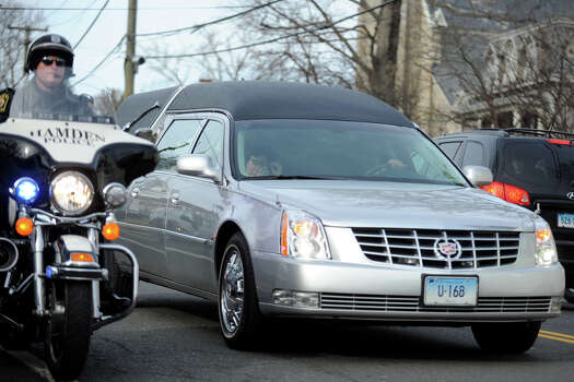 The hearse carrying the body of Benjamin Wheeler drives down Main Street following his funeral at Trinity Episcopal Church, in Newtown, Conn., Dec. 20th, 2012. Wheeler is one of twenty students killed in the mass shooting at Sandy Hook Elementary School last Friday. Photo: Ned Gerard / Connecticut Post