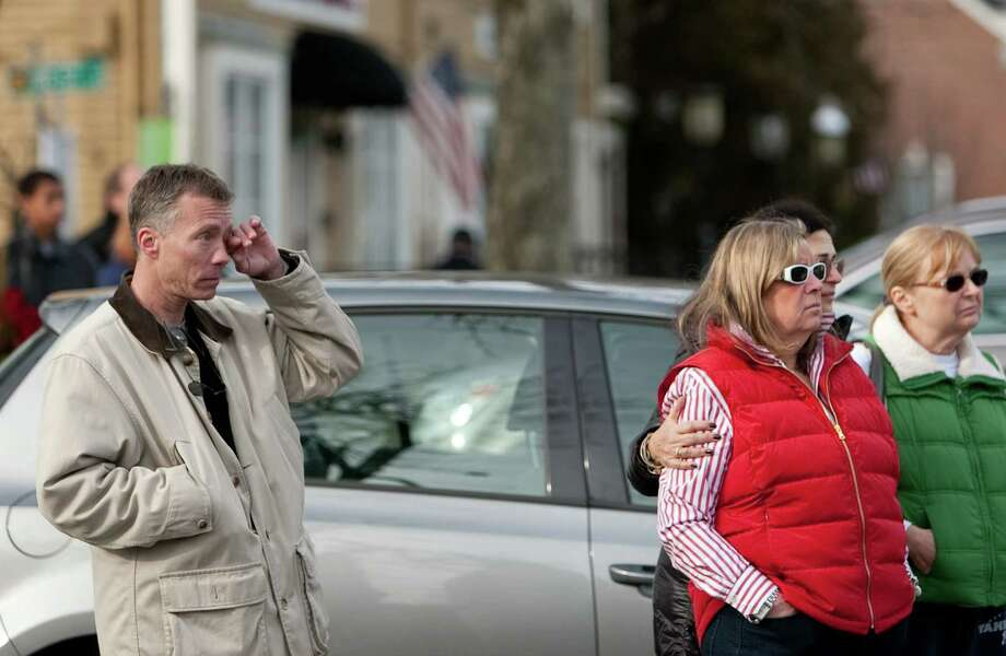 People watch as the casket is carried from the building during the funeral for six year-old Benjamin Andrew Wheeler at Trinity Episcopal Church in Newtown on Thursday, December 20, 2012. Photo: Joshua Trujillo, Joshua Trujillo/Hearst Newspaper / News-Times