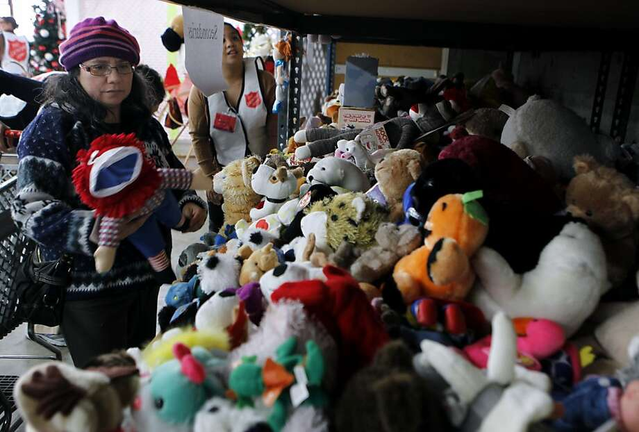 Rose Ort selects Raggedy Ann from a shelf filled with dolls and plush toys at a Salvation Army holiday toy giveaway in San Francisco, Calif. on Thursday, Dec. 20, 2012. Photo: Paul Chinn, The Chronicle