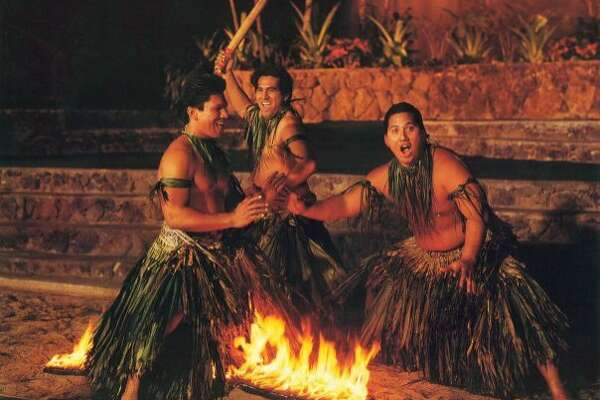 Firewalking, seen in this 1980s photo, has long been a popular form of Samoan-style entertainment at the Polynesian Cultural Center.