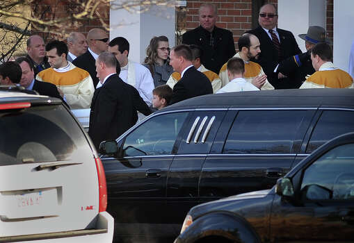The casket of Catherine Violet Hubbard, one of the twenty students killed in the Sandy Hook Elementary School shooting, is carried from St. Rose of Lima Catholic Church in Newtown on Thursday, December 20, 2012. Photo: Brian A. Pounds / Connecticut Post