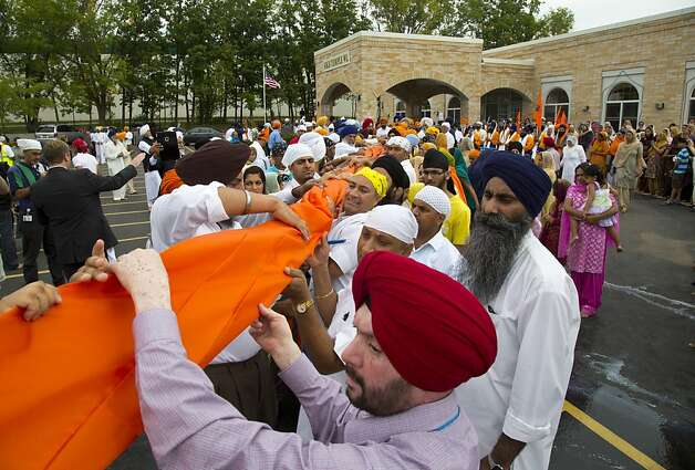 A flag ceremony is held in August outside the Wisconsin temple where six Sikhs were slain. Out of the tragedy, some Sikhs found an opportunity to increase awareness, including in California universities. Photo: Jeffrey Phelps, Associated Press