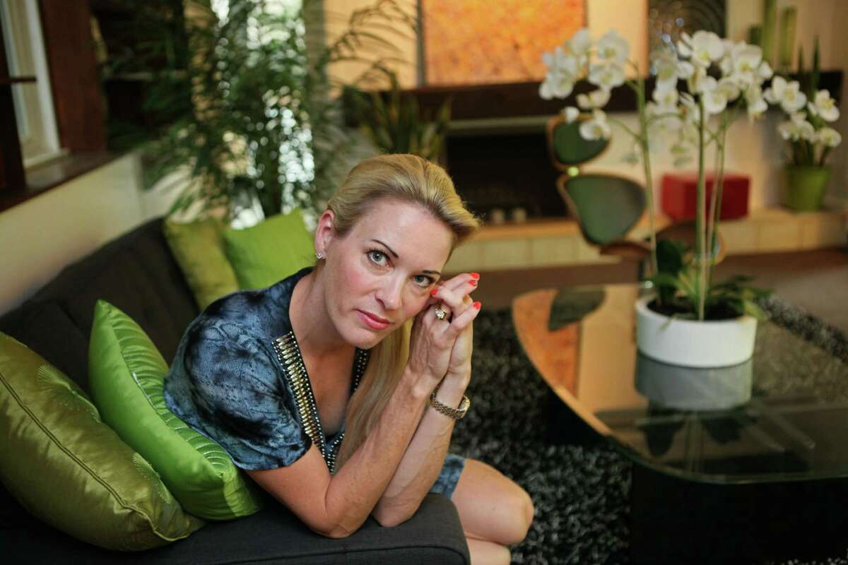 Suzy Favor Hamilton poses for a portrait at her home in Shorewood Hills a suburb of Madison, Wis. in 2012. The three-time Olympian has admitted leading a double life as an escort. She apologized Thursday after a report by The Smoking Gun website said she had been working as a prostitute in Las Vegas. (AP Photo/Milwaukee Journal-Sentinel, Michael Sears)