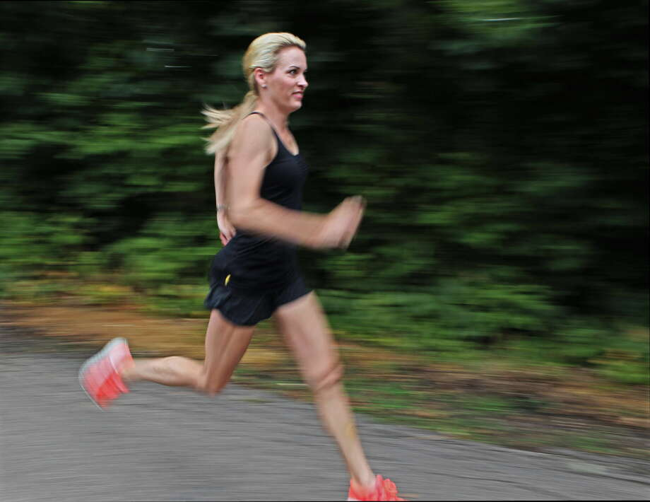Suzy Favor Hamilton runs at her home in Shorewood Hills a suburb of Madison, Wis., in 2012. (AP Photo/Milwaukee Journal-Sentinel, Michael Sears) Photo: Getty Images