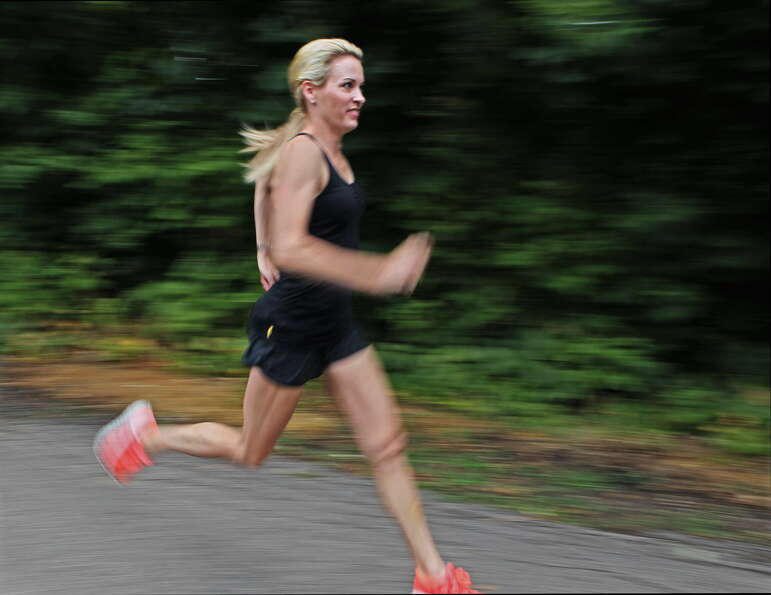 Suzy Favor Hamilton runs at her home in Shorewood Hills a suburb of Madison, Wis., in 2012. (AP Phot