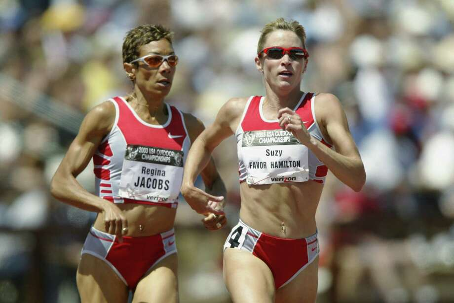 Suzy Favor Hamilton (r) and Regina Jacobs (l) finish 1 and 2 in the women's 1500m final at the USA Outdoor Track and Field Championships on June 21, 2003 at Cobb Track and Angell Field at Stanford University in Palo Alto, California. Photo: Andy Lyons, Getty Images / 2003 Getty Images