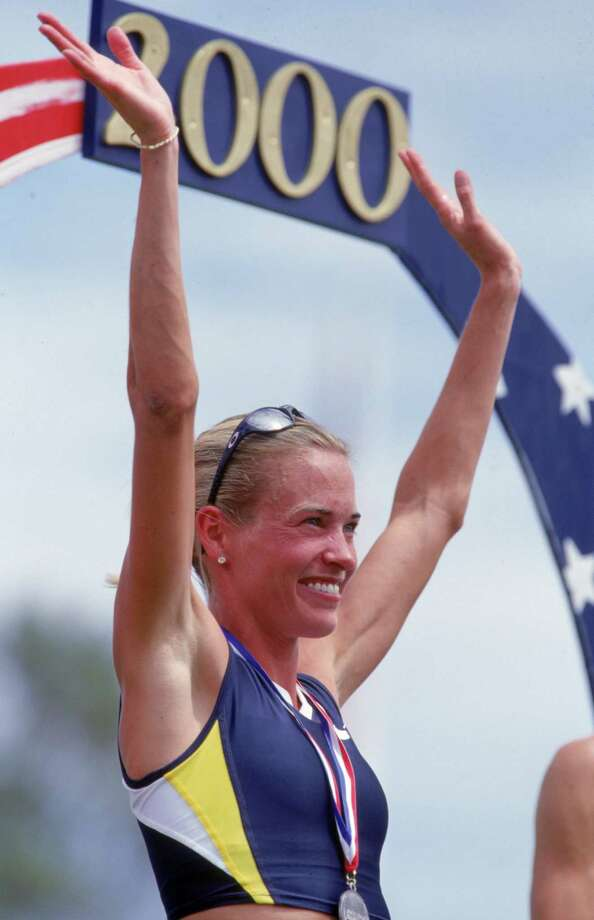 Suzy Favor-Hamilton of the USA celebrates on the winners podium after the Women's 1,500 meter event of the 2000 U.S. Olympic Track & Field Team Trials at the Hornet Stadium in Sacramento, California. Photo: Andy Lyons, Getty Images / Getty Images North America