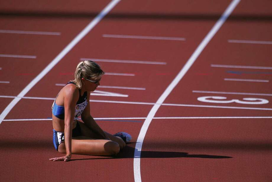Suzy Favor-Hamilton of the United States sitting during the Women's  1,500M Event for the IAAF World Championships at the Commonwealth  Stadium in Edmonton, Alberta, Canada. Photo: Getty Images
