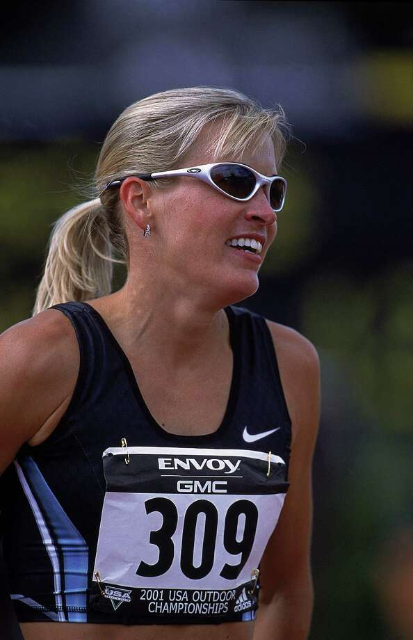 Suzy Favor-Hamilton looks on during the Women's 1,500m Run for the USA Track and Field Championships at Hayward Field in Eugene, Ore., in 2001. Photo: Matthew Stockman, Getty Images / Getty Images North America