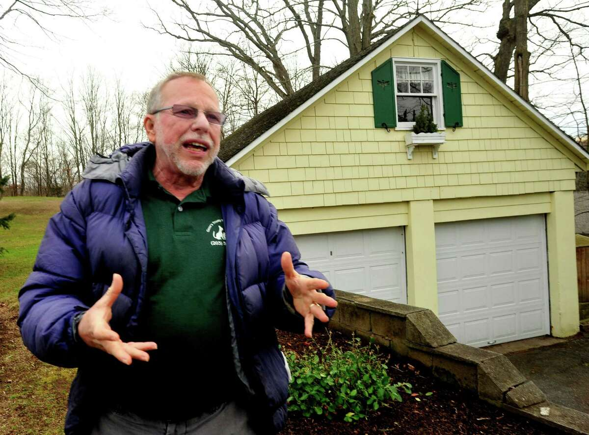 Gene Rosen stands in front of his Newtown garage, where his cats live. He came home last Friday morning to feed them and found six children from neighboring Sandy Hook Elementary School huddled on his lawn. Photographed Thursday, Dec. 20, 2012.