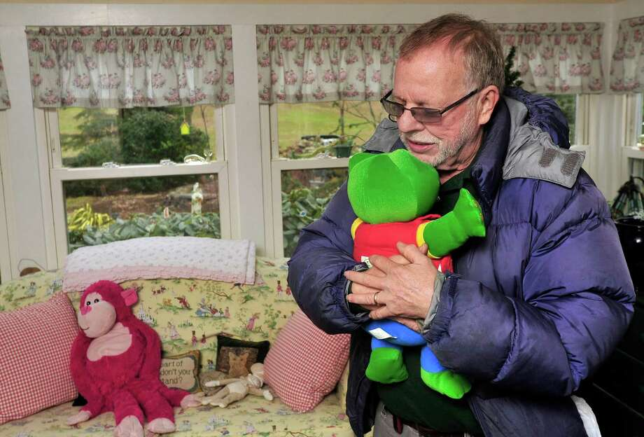 Gene Rosen stands in his Newtown home and shows the spot where he first brought six children from neighboring Sandy Hook Elementary School  last Friday and gave them stuffed animals to comfort them. Photographed Thursday, Dec. 20, 2012. Photo: Michael Duffy / The News-Times