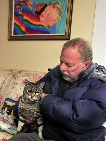 Gene Rosen holds Kevie, one of his cats, in his Newtown home and talks about six children from neighboring Sandy Hook Elementary School he took in last Friday. Photographed Thursday, Dec. 20, 2012. Photo: Michael Duffy / The News-Times