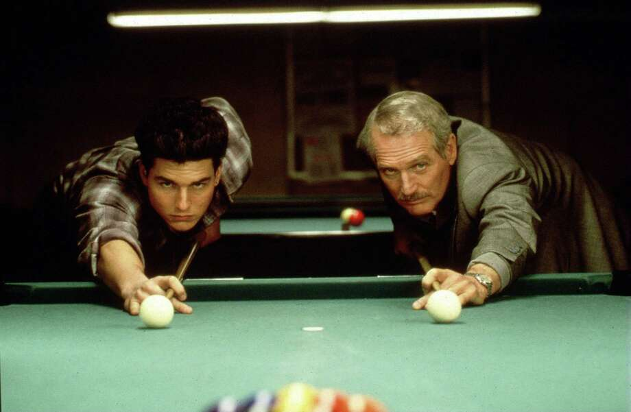 Pool room con artist 'Fast Eddie' Felson (Paul Newman, R) exposes the tricks of the trade to novice Vincent Laruia (Tom Cruise, L) in the network premiere of THE COLOR OF MONEY Wednesday, Aug. 12 (8:00-10:00 PM ET/PT) on Fox.    Exclusively for use in advertising and promotion relating to television exhibition through Fox Broadcasting Company. All rights reserved.  1998 Fox Broadcasting Company CR: Fox Photo: STF / Fox Broadcasting Company