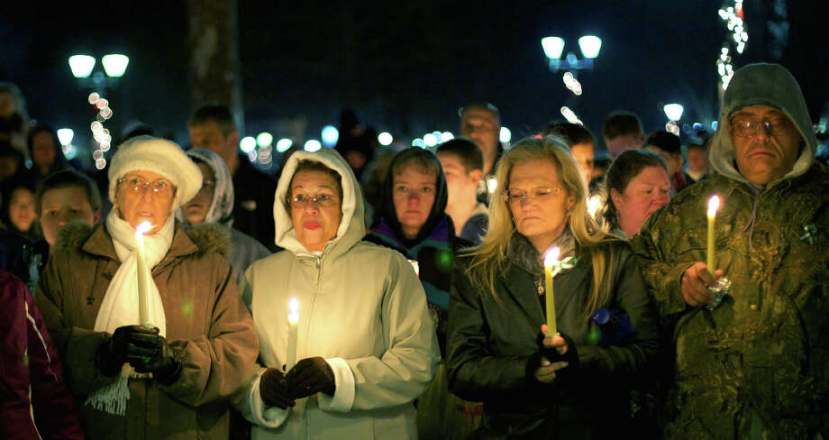 Thoughts were with those in Newtown mourning their lost loved ones Sunday, Dec. 16, 2012 during a vigil on the New Milford Village Green in remembrance of Friday's tragic events in Sandy Hook. Photo: Trish Haldin
