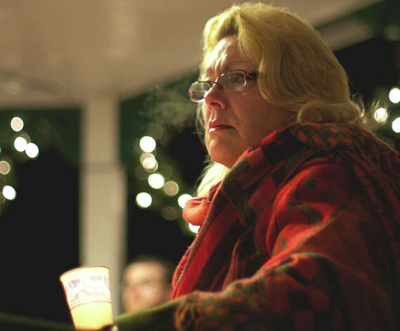 Mayor Pat Murphy is deep in her thoughts as she shares in the community grief during the vigil on the New Milford Village Green in remembrance of Friday's tragic events in Newtown. Photo: Trish Haldin