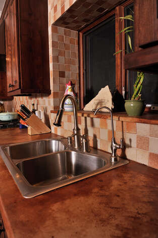 Concrete counter-tops and a tile backsplash in the home of Randy Rodgers. Photo: Robin Jerstad/For The Express-Ne