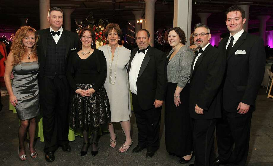 Menands, NY - December 7, 2012 - (Photo by Joe Putrock/Special to the Times Union) - (l to r) Yvonne Carins, Doug Clark, Esq., Madeline Fiorino, Cindy Shenker, Esq., Richard Lauricella, Emily Whalen, Esq., Chris Del Giudice, Esq. and Ryan Horstmyer, Esq. of event gold sponsor Wilson Elser during the 29th Annual Dancing in the Woods gala, a benefit for the Melodies Center for Childhood Cancer and Blood Disorders at the Children?s Hospital at Albany Medical Center. Photo: Joe Putrock