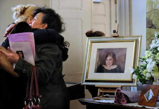 Mourners embrace in the vestibule of the First Congregation Church in Danbury, Conn. Thursday, Dec. 20, 2012, before the funeral service for Sandy Hook shooting victim, Lauren Rousseau.