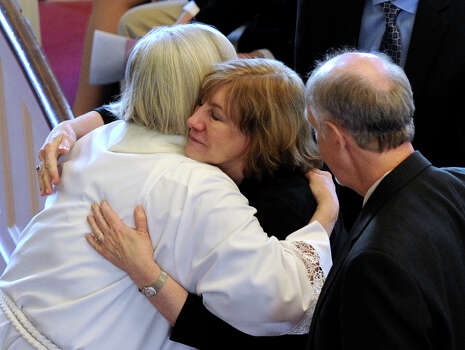 Terri Rousseau, center, mother of Sandy Hook shooting victim, Lauren Rousseau, is embraced by clergy at the conclusion of a funeral service at the First Congregational Church in Danbury, Conn., Thursday, Dec. 20, 2012. Photo: Carol Kaliff / The News-Times