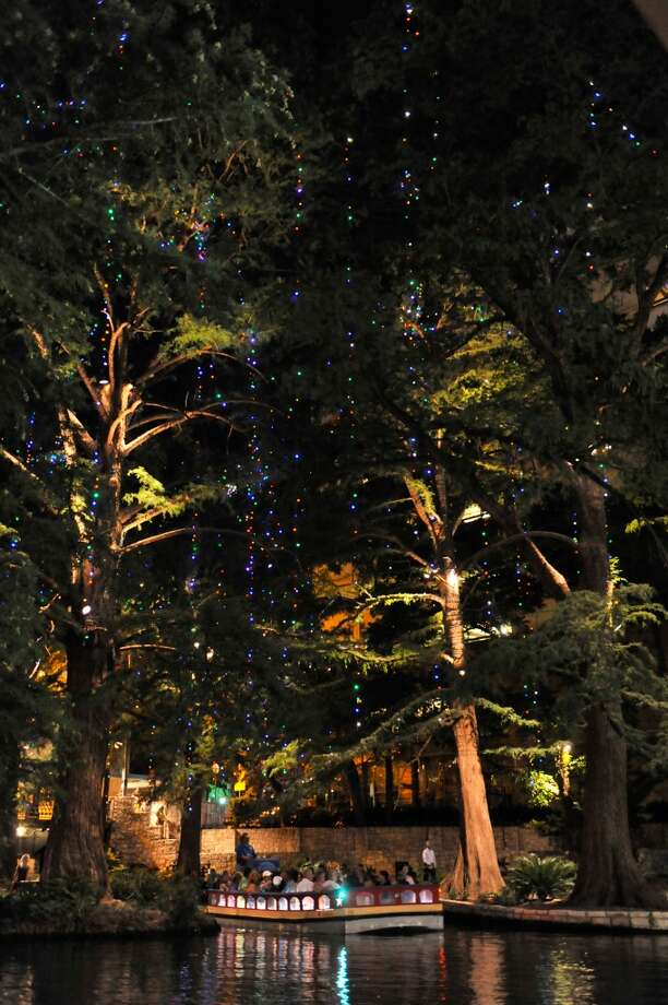 Do a Tarzan using the River Walk lights. (SPECIAL TO THE EXPRESS-NEWS)