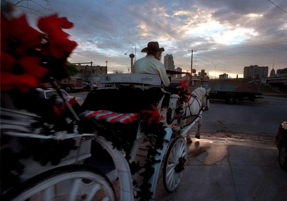 Take a horse-drawn carriage ride down Houston Street.