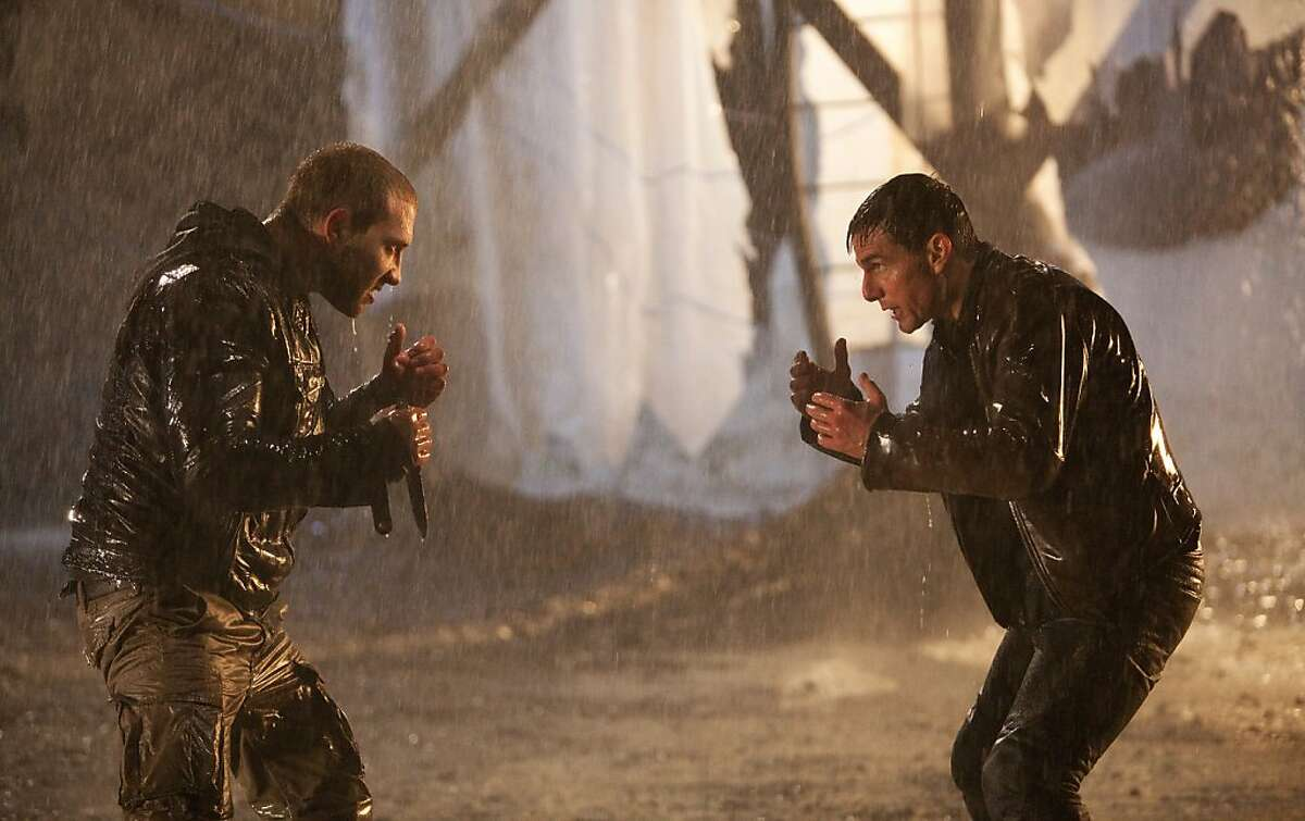 This undated publicity photo released by Paramount Pictures shows Tom Cruise, right, as Reacher and Jai Courtney as Charlie in the film,