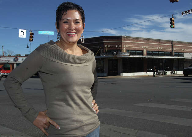 Rosario's restaurant owner Lisa Wong stands across the street from the old Texas Highway Patrol Museum Thursday December 20, 2012. Wong plans to file a court motion in Travis County to request a hearing about the sale of the Texas Highway Patrol Museum property. Photo: JOHN DAVENPORT, San Antonio Express-News / ©San Antonio Express-News/Photo Can Be Sold to the Public