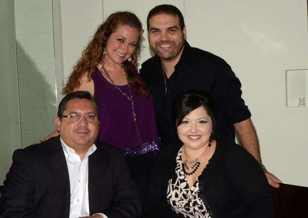 Johnny Saenz and his wife Lori (bottom from left) and Melissa Turi and her husband John (top from left) enjoy a double-date at PHX Lounge on December 8, 2012. Photo: Robin Johnson