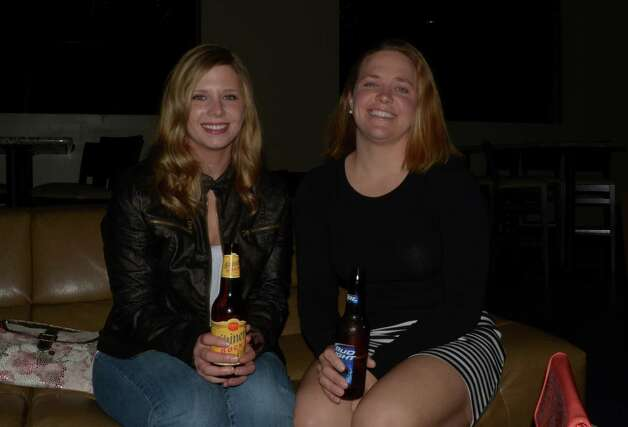 Shelby Bandy (left) and Julie Hoysradt have a ladie's night at PHX Lounge with beers and appitizers on December 8, 2012. Photo: Robin Johnson