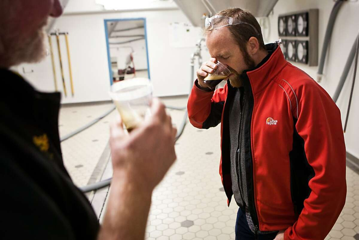 Sierra Nevada Head Brewer Steve Dresler, left, and Research and Development Head Brewer Scott Jennings, right, taste Ovila Abbey Quad with Plums at the brewery in Chico, Calif., December 18, 2012.