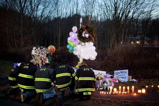 1. The nation mourns after a gunman kills 26 people, including 20 children, at Sandy Hook Elementary School in Newtown, Conn.  The rampage comes five months after a mass shooting at a Colorado theater left 12 dead, including San Antonian Jessica Ghawi. Photo: MARCUS YAM, New York Times / NYTNS
