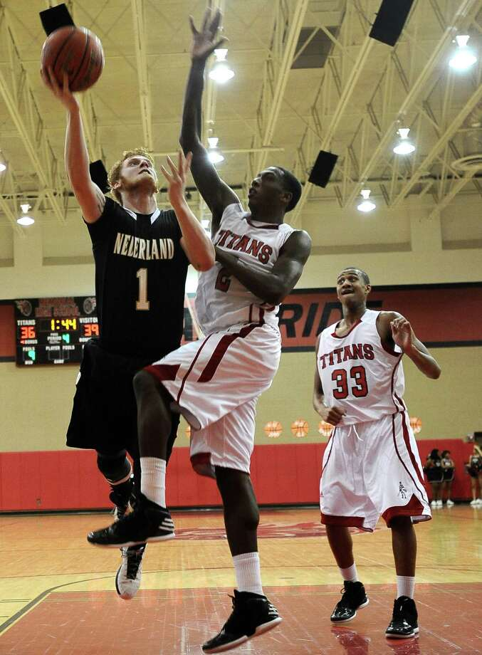 Nederland forward Colton Weisbrod, #1, puts the ball up for two points during the Memorial High School basketball game against the Nederland High School on Tuesday December 11, 2012, at Memorial High School. Nederland won over Memorial 42- 41. Photo taken: Randy Edwards/The Enterprise