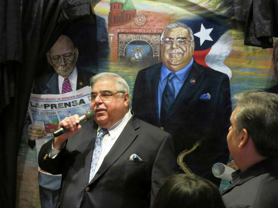 Precinct 2 Commissioner Paul Elizondo thanks family and friends on Dec. 20, 2012, at a ceremony to unveil his image as part of a mural of historic Latino figures at Mi Tierra Restaurant. Begun 22 years ago, the mural features dozens of local, national and foreign leaders. Elizondo, a former teacher and orchestra leader, has been a Bexar County commissioner since 1983 and also served in the Texas House.  Photo: John W. Gonzalez