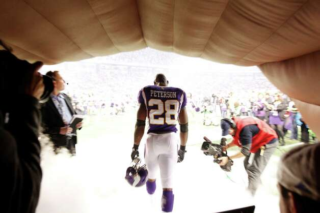 Minnesota Vikings running back Adrian Peterson (28) enters the field before kickoff against the Chicago Bears Sunday, Dec. 9, 2012, in Minneapolis.  Photo: Genevieve Ross, Associated Press / FR170496 AP