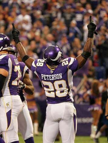 Minnesota Vikings running back Adrian Peterson celebrates after scoring a touchdown during the first half against the Chicago Bears Sunday, Dec. 9, 2012, in Minneapolis. Photo: Andy King, Associated Press / FR51399 AP
