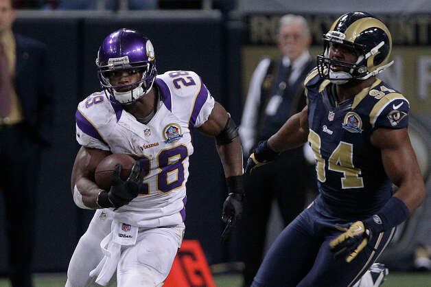 Minnesota Vikings running back Adrian Peterson (28) runs with the ball during the fourth quarter against the St. Louis Rams on Sunday, Dec. 16, 2012, in St. Louis. (AP Photo/Seth Perlman) Photo: Seth Perlman, Associated Press / AP