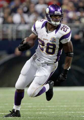 Minnesota Vikings running back Adrian Peterson runs with the ball during the third quarter of an NFL football game against the St. Louis Rams Sunday, Dec. 16, 2012, in St. Louis. (AP Photo/Seth Perlman) Photo: Seth Perlman, Associated Press / AP