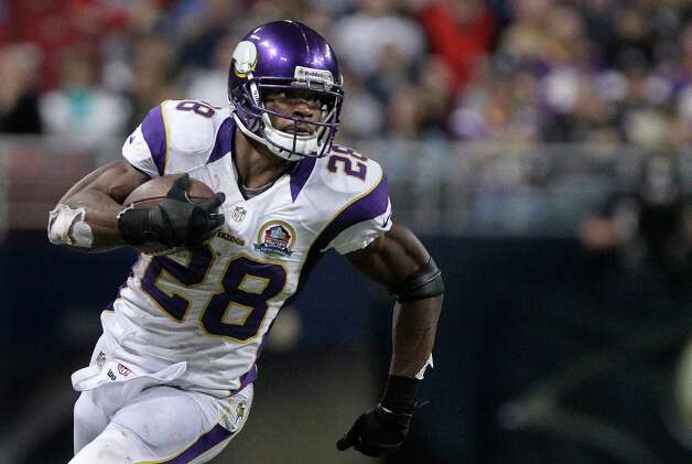 Minnesota Vikings running back Adrian Peterson runs with the ball during the third quarter against the St. Louis Rams Sunday, Dec. 16, 2012, in St. Louis. (AP Photo/Seth Perlman) Photo: Seth Perlman, Associated Press / AP