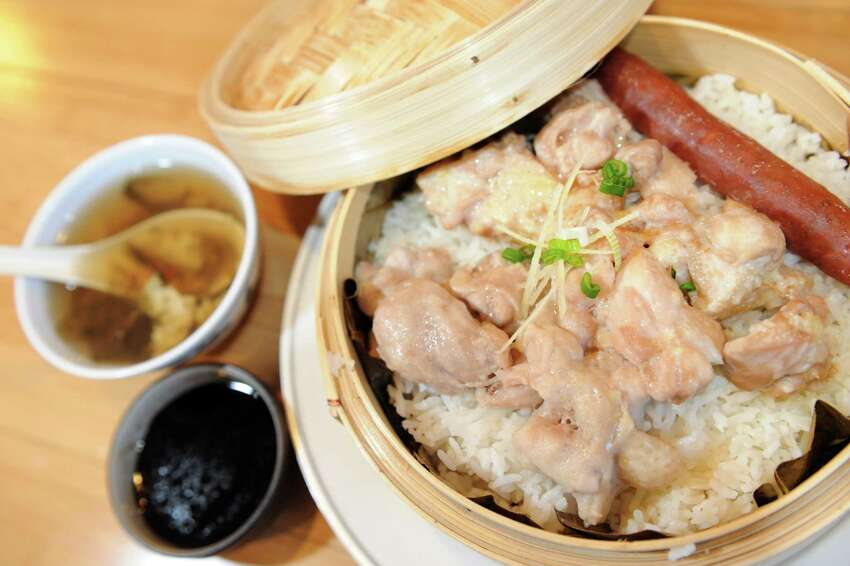 Chinese sausage with chicken and steamed rice in a bamboo basket and sides of soy sauce and seaweed egg-drop soup on Saturday, Dec. 15, 2012, at Taiwan Noodle in Albany, N.Y. (Cindy Schultz / Times Union)