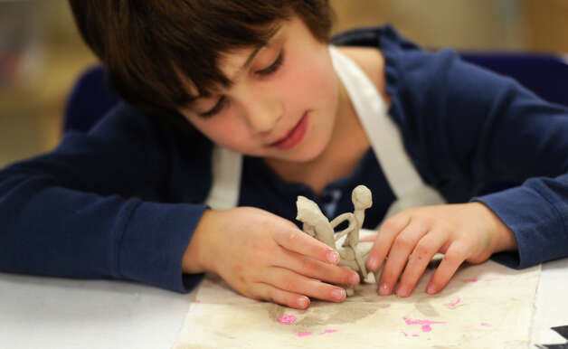 Jesse Levine puts together a horse and rider during her clay sculpting class at the Albany Institute of History and Art December 28, 2010.(Skip Dickstein / Times Union) Photo: Skip Dickstein / 00011468A