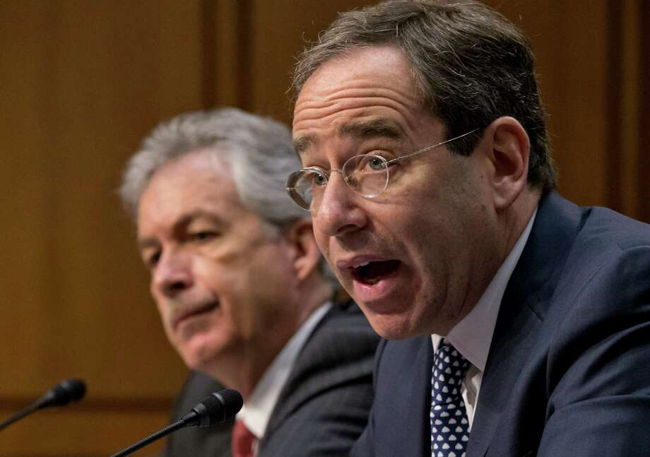 Thomas Nides, right, and William Burns testify Thursday before the Senate Foreign Relations Committee over inadequate security in Benghazi, Libya. Photo: J. Scott Applewhite, STF / AP