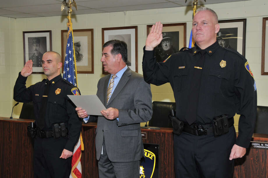 Steven Perrotta and Christopher Broems are sworn in as sargeants by Mayor Michael Pavia at the Stamford Police Department on Thursday. Photo: Contributed Photo
