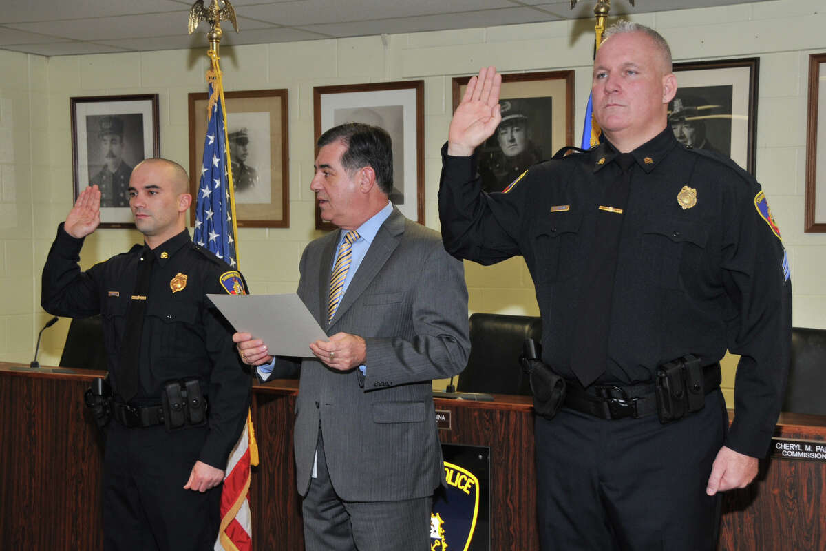 Steven Perrotta, left, and Christopher Broems are sworn in as sergeant by Mayor Michael Pavia at the Stamford Police Department. Perrotta was involved in the fatal shooting of Dylan Pape.