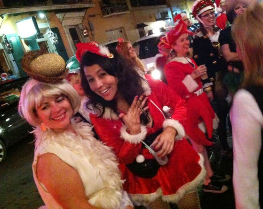Reveling Krewe-members outside Pat O'Brien's Bar in the French Quarter.