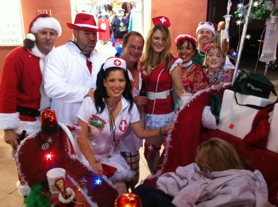 The Krewe of Kringle inner circle (this year's event had a medical theme).