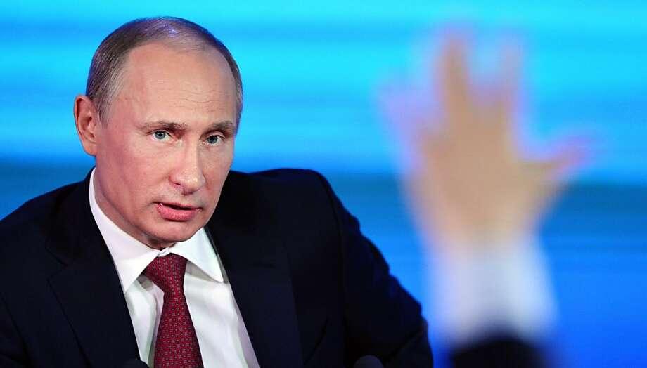 "Vladimir Putin says: ""Change is on the agenda."" Photo: Natalia Kolesnikova, AFP/Getty Images"