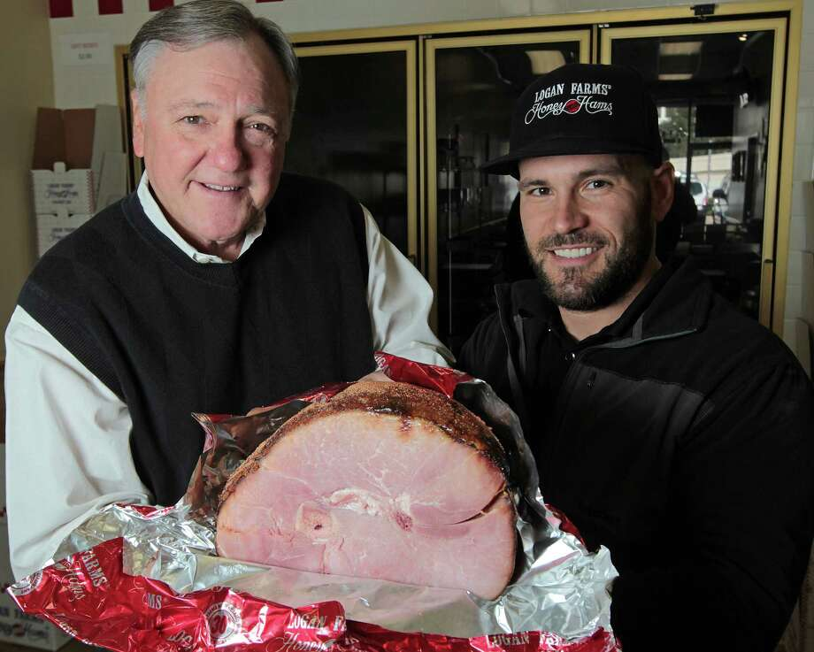 Logan Farms owner Pink Logan, left, and his son Jim Logan sell about 200,000 holiday hams a season from three local storefronts. The company was built on a hankering for ham and the elder Logan's salesman know-how. Photo: James Nielsen, Staff / © Houston Chronicle 2012