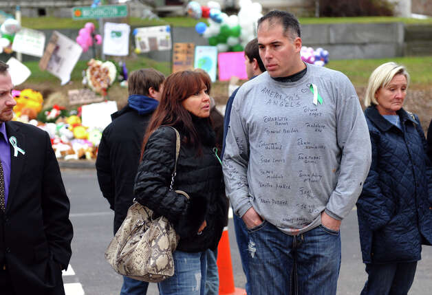 Craig Andreozzi and his fiance Delfy Campuzano traveled from Providence, RI to see the massive memorial set up for victims from last Friday's shooting massacre at Sandy Hook Elementary School in Newtown, Conn. on Thursday December 20, 2012. Craig put the names of all of the students and teachers killed onto his T-shirt. Photo: Christian Abraham / Connecticut Post